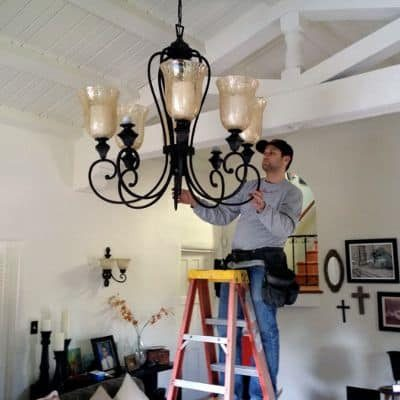 Certified-Electrician-changing-light-GP-Electricians